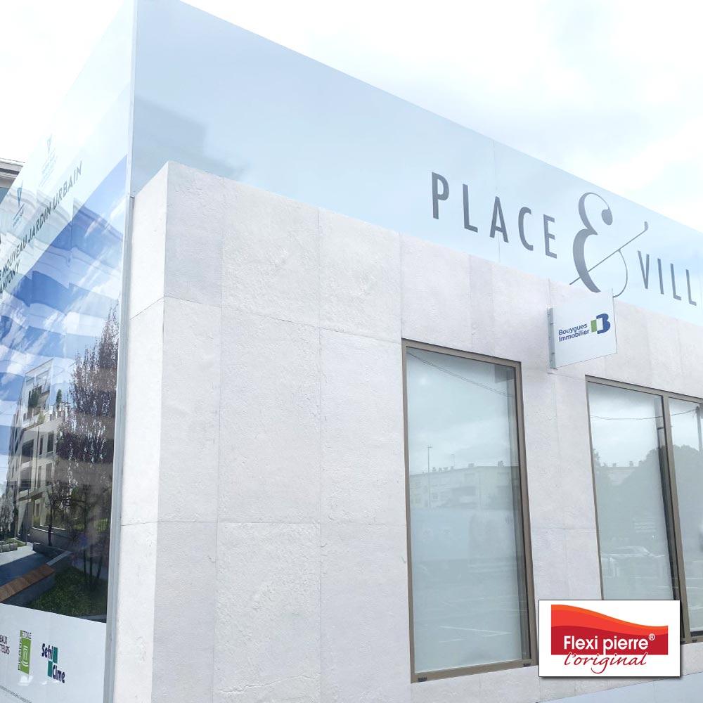 Notre référence de feuille de pierre Blanc Neptune en parement de façade sur un édifice commercial.